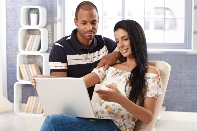 Young couple with laptop at home